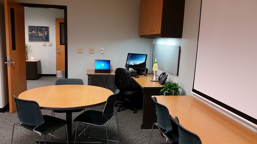 Workstation and conference tables in 1253B.