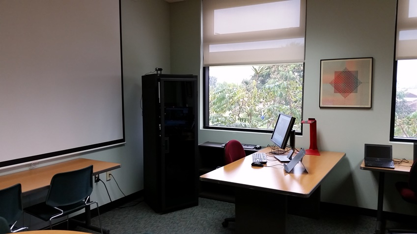 View of the instructor station in 1253B. This work station controls the overhead projector and has a webcam and microphone.