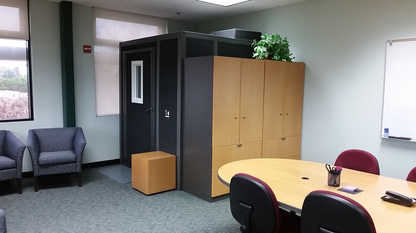 Back cabinets and entry to the audio and video recording sound booth.