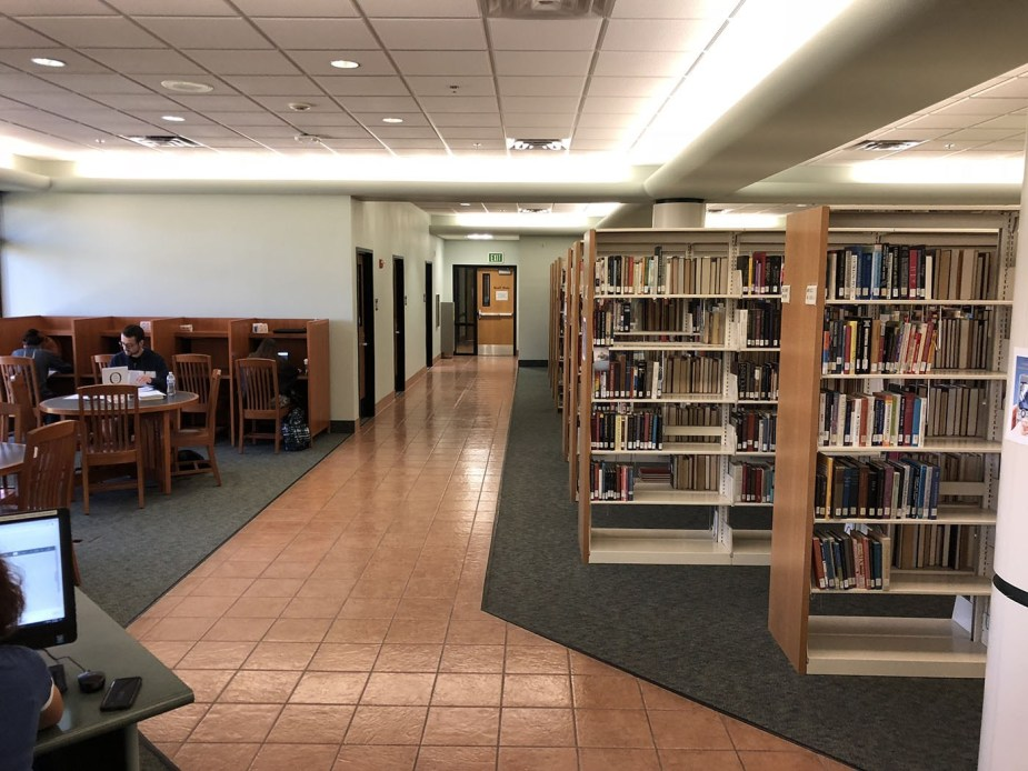 During library hours, you may also enter from the second floor of the library. Follow the tile to the left rear and pass through two doors.